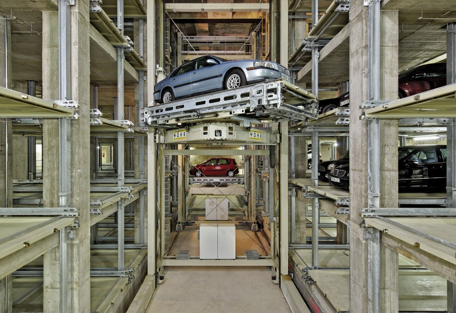 This robotic parking garage by manufacturer Woehr is similar to the one planned for Seattle Cancer Care Alliance in Seattle. It can be taken apart, like Legos, leaving an underground box that may be converted to some other use when the parking garage becomes obsolete.