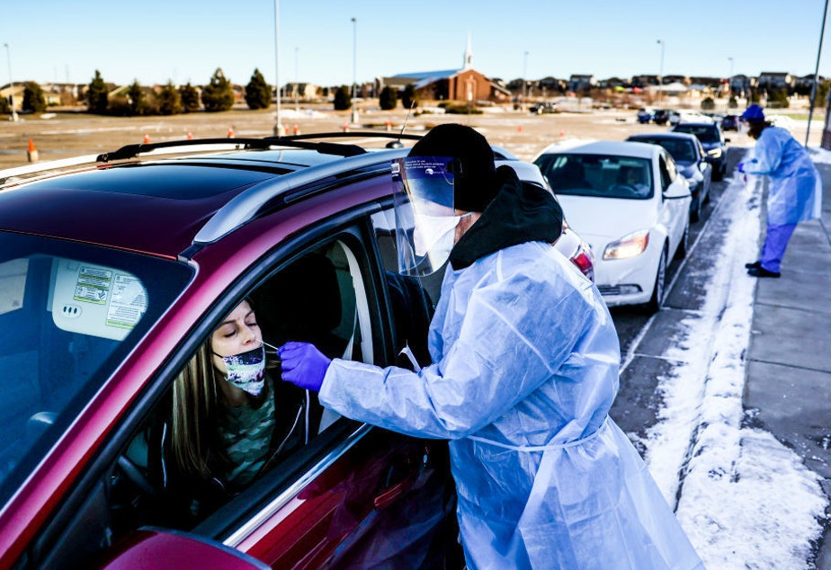 caption: A coronavirus variant that is thought to be more contagious was detected in the United States in Elbert County, Colo., not far from this testing site in Parker, Colo. The variant has been detected in several U.S. states.