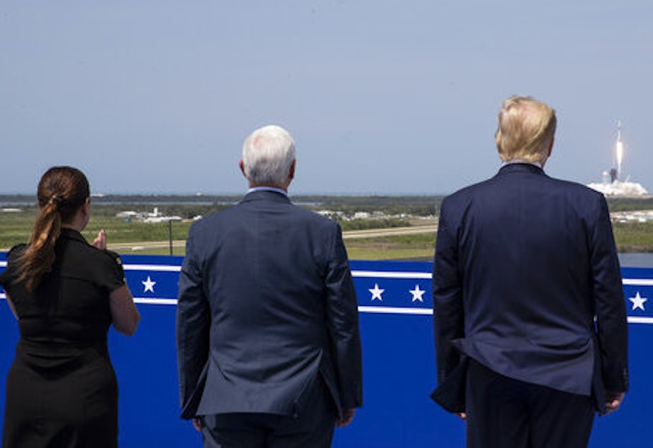 caption: President Trump, Vice President Pence and Karen Pence view the SpaceX flight to the International Space Station at Kennedy Space Center, Saturday in Cape Canaveral, Fla.