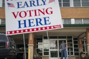 A man arrives at an early voting polling place at the Williamson County Clerk's office, Wednesday in Franklin, Tenn.