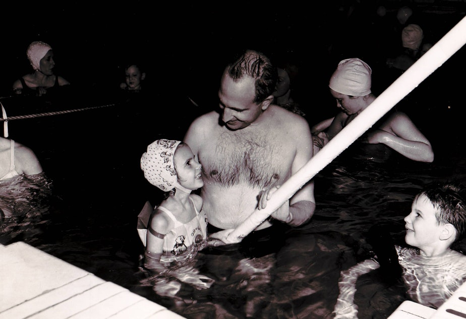 caption: Kathy Parrish as a child with her father, George Dean, at the YWCA pool in Seattle. The pool would be heated to a higher degree for polio patients at certain times.