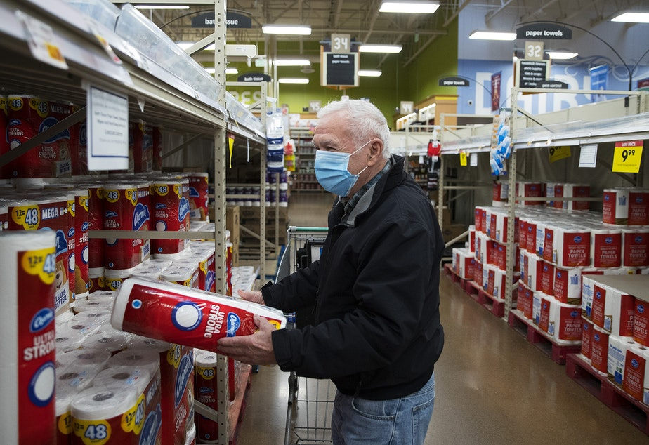 caption: Richard grocery shops in the bath tissue aisle at Fred Meyer on Monday, November 16, 2020, on Northwest 45th Street in Seattle. New statewide restrictions were announced by Gov. Jay Inslee on Sunday to curb the rapid spread of Covid-19.