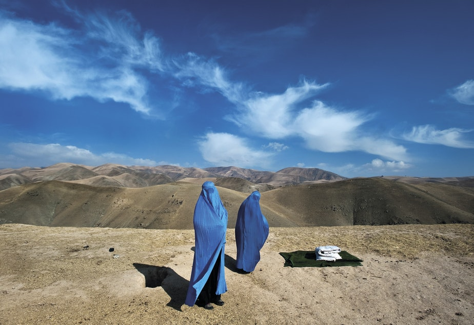 Noor Nisa, 18 (right), was in labor and en route to the hospital with her mother and husband, in Badakhshan Province, Afghanistan, when his car broke down. Lynsey Addario ended up driving Nisa to the hospital, where she delivered a baby girl. November 2009