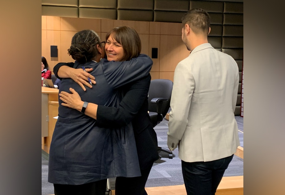 caption: Technology Access Foundation co-founder Trish Millines-Dziko (left) and Seattle Public Schools superintendent Denise Juneau (middle) share an embrace before signing a partnership agreement.