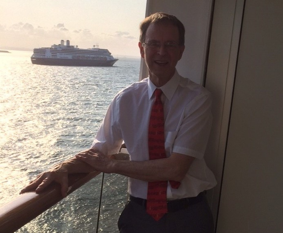 caption: Kim Peterson in his stateroom aboard the Zandaam off Panama City. In the background is another cruise ship, the Rotterdam, which has been taking on healthy passengers from the Zandaam. But Peterson and his wife have not been allowed to transfer over worries about their exposure to the coronavirus.