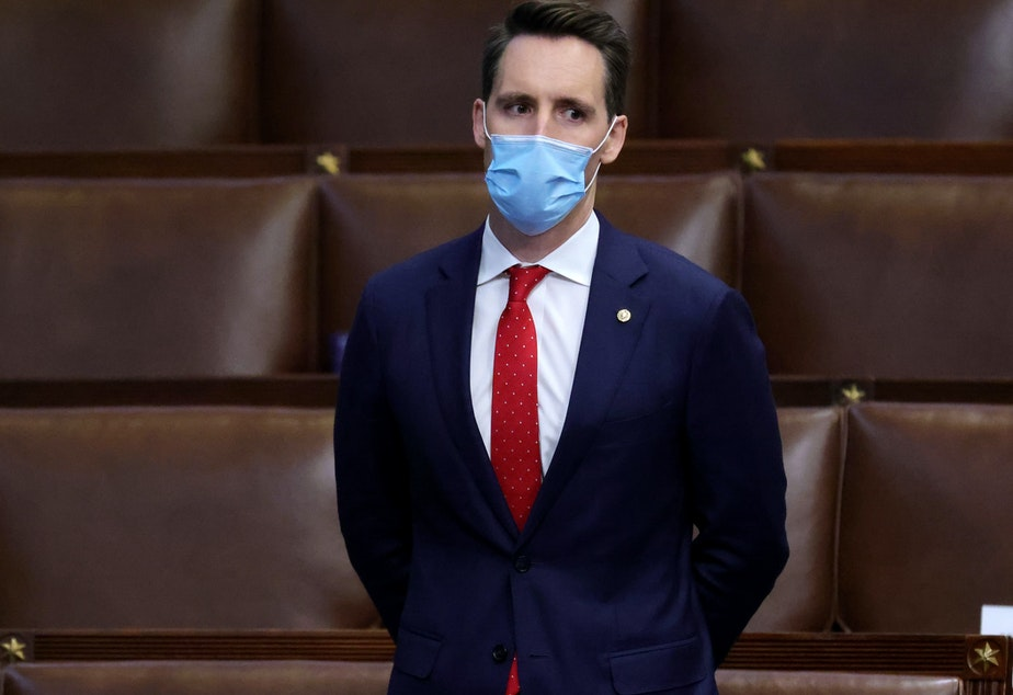 caption: Sen. Josh Hawley, R-Mo., seen here during a reconvening of a joint session of Congress on January 06, has penned an op-ed defending his decision to object to the electoral votes certification.
