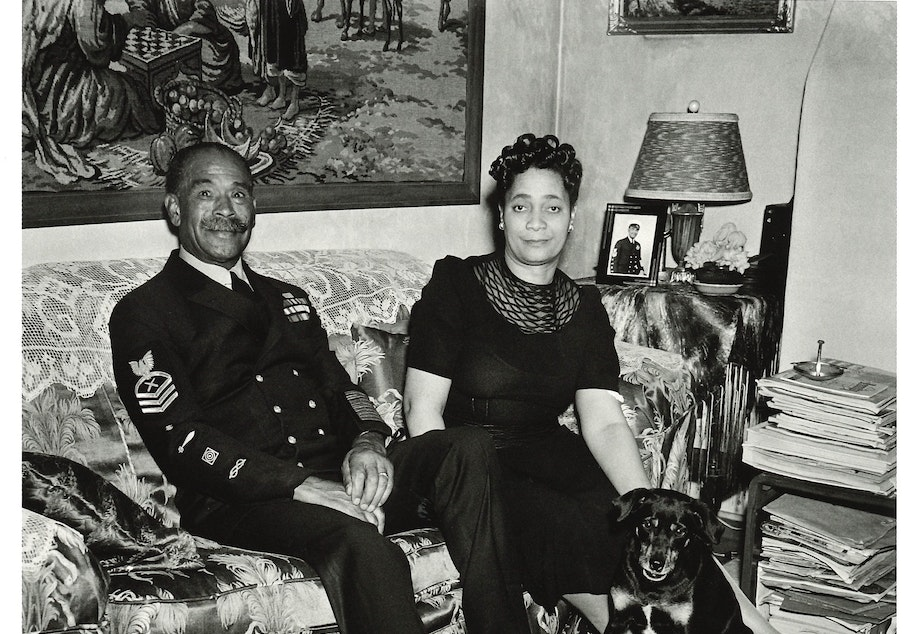 Faye Alice and John Henry 'Dick' Turpin at their home around 1944. Dick Turpin was a World War I veteran, the Navy's first black chief petty officer. He worked at the Bremerton shipyard where Al Smith, who photographed them here, also worked.