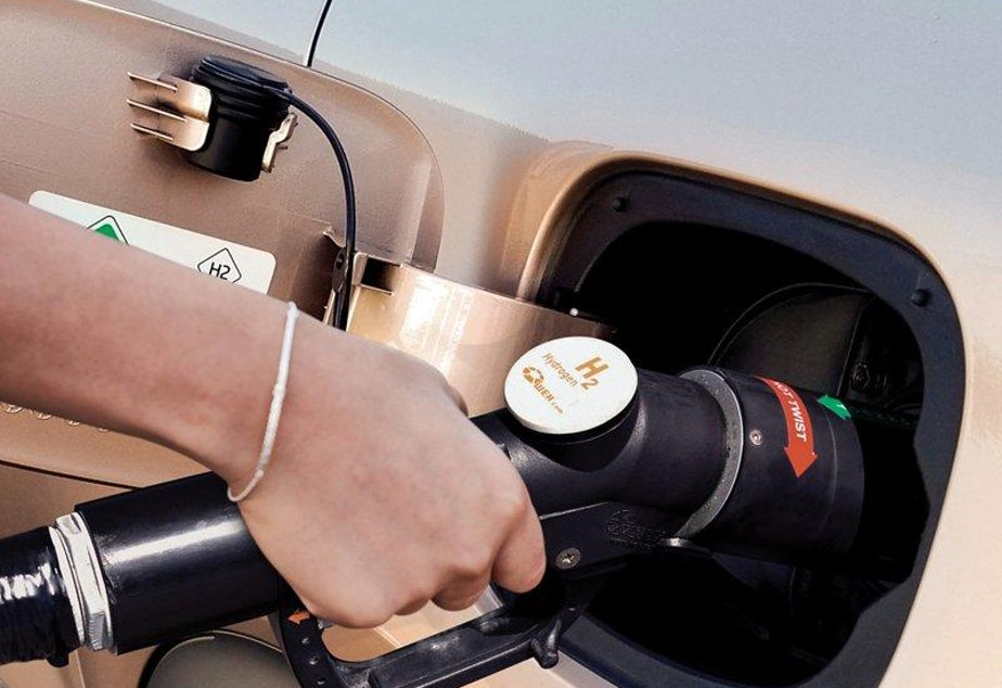 caption: Refueling a vehicle at a hydrogen gas pump could be a familiar, speedy routine akin to how consumers refuel gasoline-powered cars today.