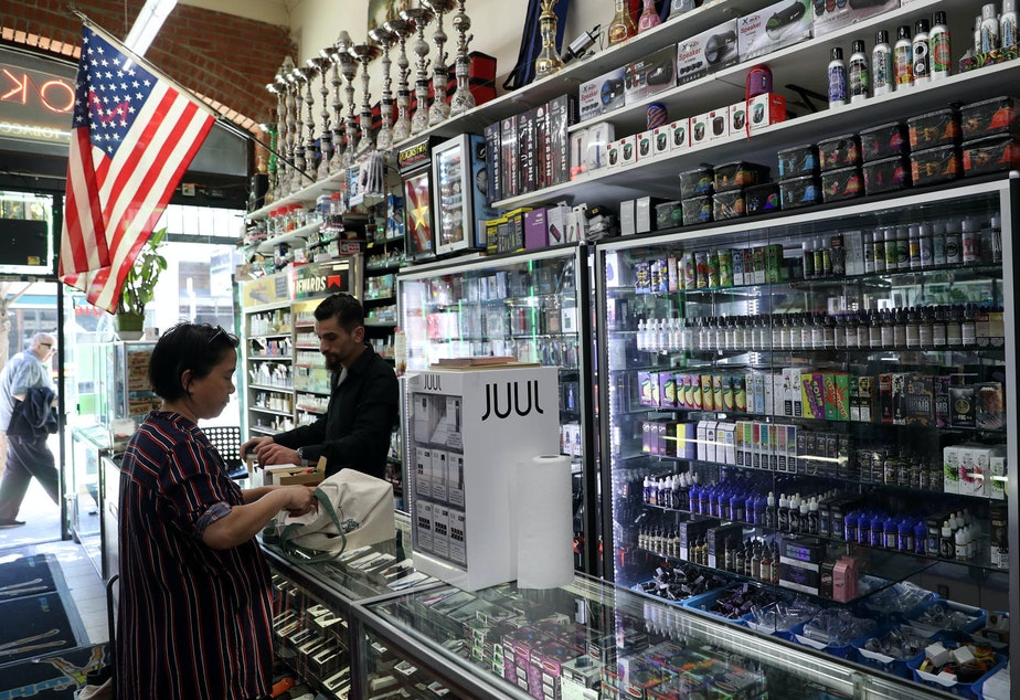 caption: E-Cigarette vaporizer components and products are displayed at Smoke and Gift Shop on June 25, 2019 in San Francisco, California.