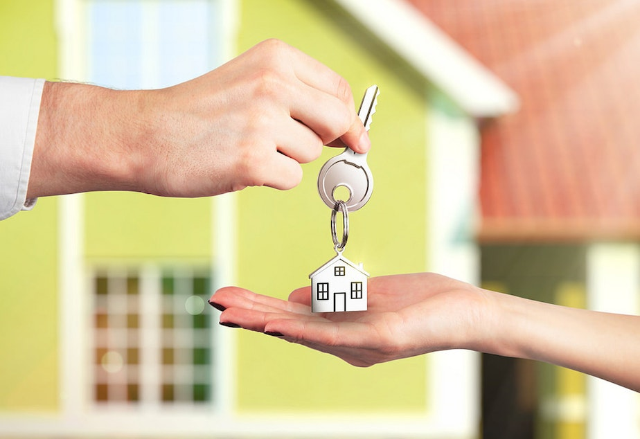 Handing over the keys to a new rental property.