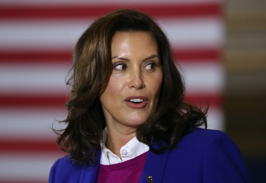 caption: Michigan Gov. Gretchen Whitmer is seen here campaigning for Democratic presidential nominee Joe Biden on Oct. 16.