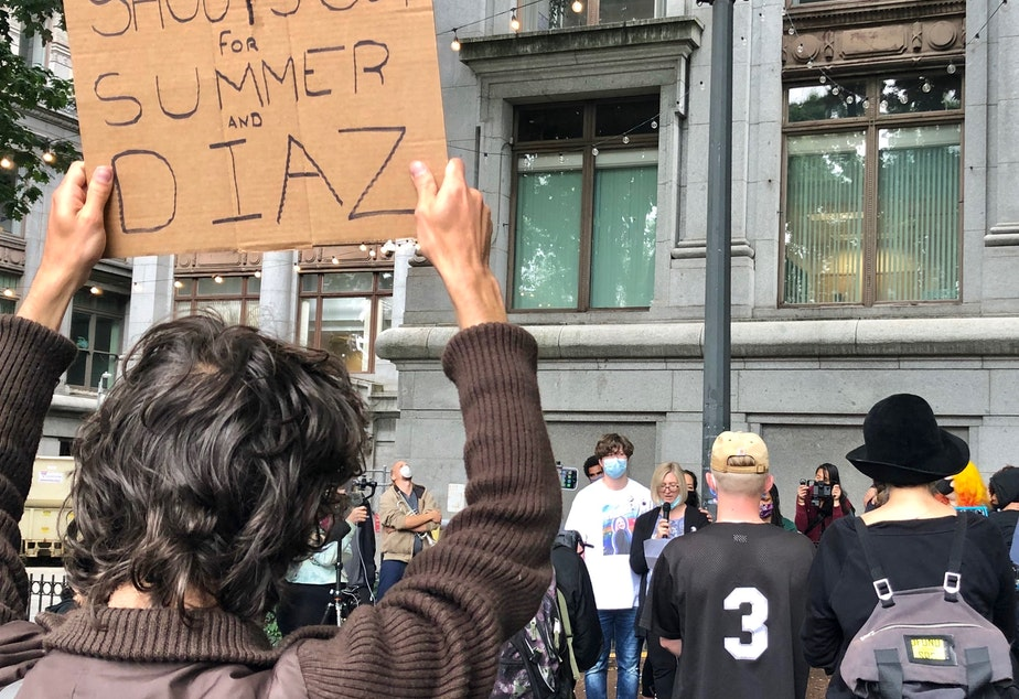 caption: Dalia Taylor, the mother of 24-year-old Summer Taylor who died on July 4 after being struck by a driver during a protest against racism and police violence, addresses a crowd gathered in downtown Seattle for a rally for Taylor and Diaz Love, another protester injured in the collision.