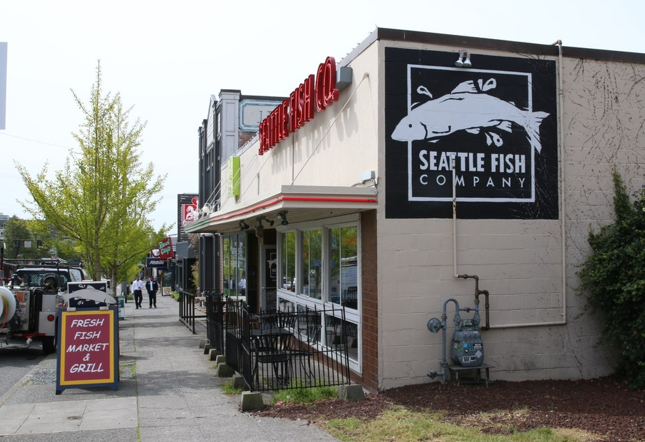 Jon Daniels, owner of the West Seattle Fish Company, says local merchants rely on parking to draw customers. For him, on the outskirts of the urban village, it's street parking. For those closer to the center, it's the free lots run by the West Seattle Junction Association.