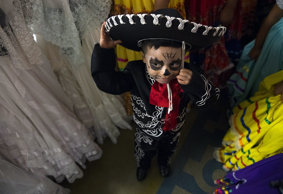 Armani Galvez, 3, stands with other Folklore Mexicano Tonantzin members before performing on Friday, November 2, 2018, during the 14th annual Día de los Muertos celebration at El Centro de la Raza in Seattle.