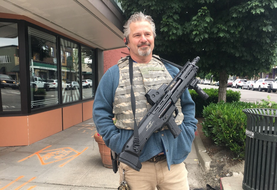 caption: Maurice Whitney is a local Renton resident and property manager. He says he's with the protesters, just not with those inflicting damage.