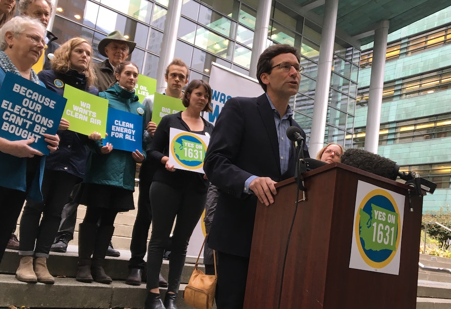 caption: Washington Attorney General Bob Ferguson speaks at a press event for the Yes on 1631 campaign.