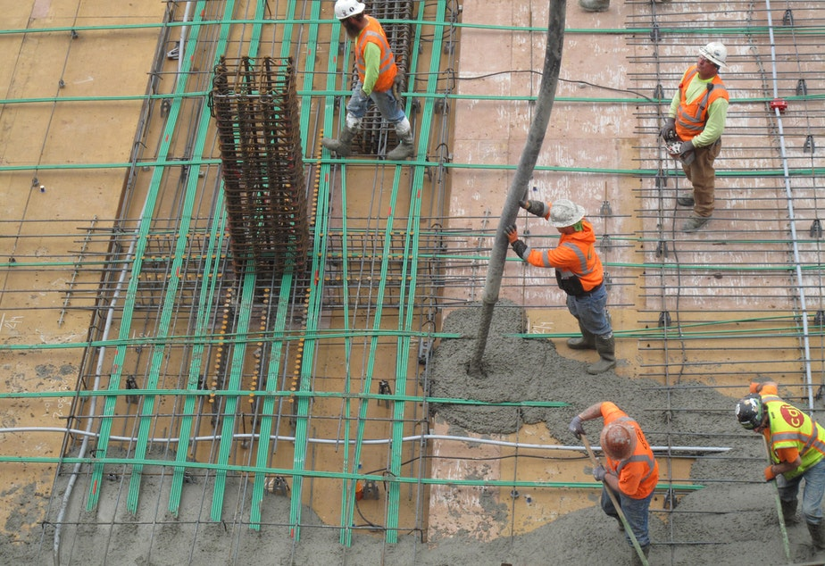 SLIDESHOW: Workers pour concrete for a floor of an office tower in Renton. Pouring concrete carries a lot of risk for workers.