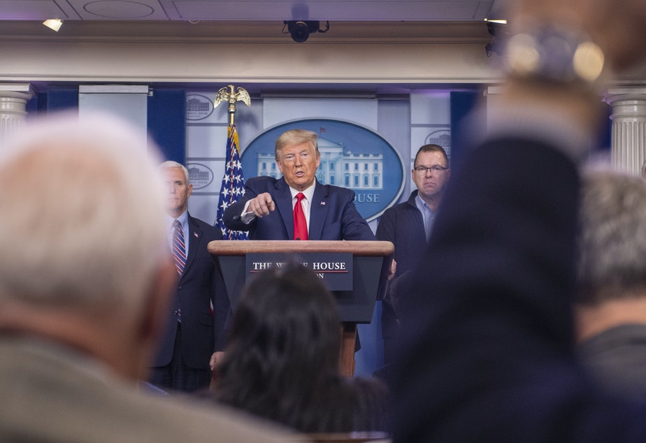 caption: President Trump says he's not using his authority to control production and distribution of medical supplies.