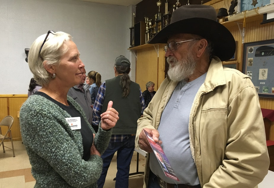caption: Ann Diamond (an Independent from Mazama) talks with Ron Morris, an independent voter, at a recent candidates' forum in Brewster.