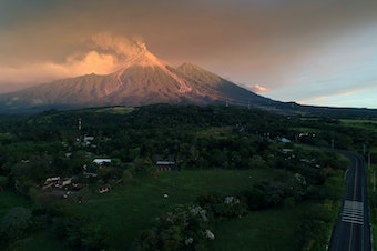 The Volcano of Fire spewed lava and ash on Monday, as seen from Escuintla, Guatemala. Guatemalan authorities on Monday declared a red alert after the volcano erupted again, forcing thousands of residents to flee.