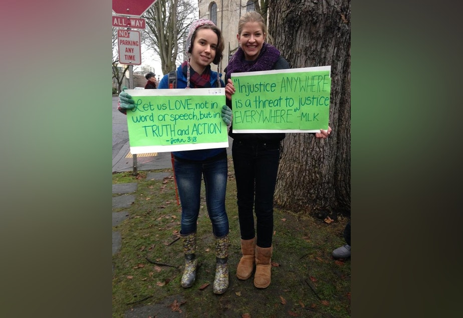 caption: Holy Names students Audrey Long and Theresa Edwards at a December rally outside the Archdiocese of Seattle in support of former Eastside Catholic Vice Principal Mark Zmuda.
