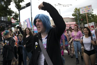 Katherine Robichaux, 27, chants during the Trans Pride Seattle march on Friday, June 22, 2018, in Capitol Hill.