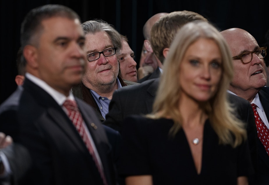 Stephen Bannon, center left, back, campaign CEO for Republican presidential candidate Donald Trump, looks on as Trump speaks during a campaign rally on Election Day.