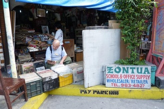 <p>Mikey Horteleza (DJ Grim) on the hunt for Filipino records in Manila.</p>