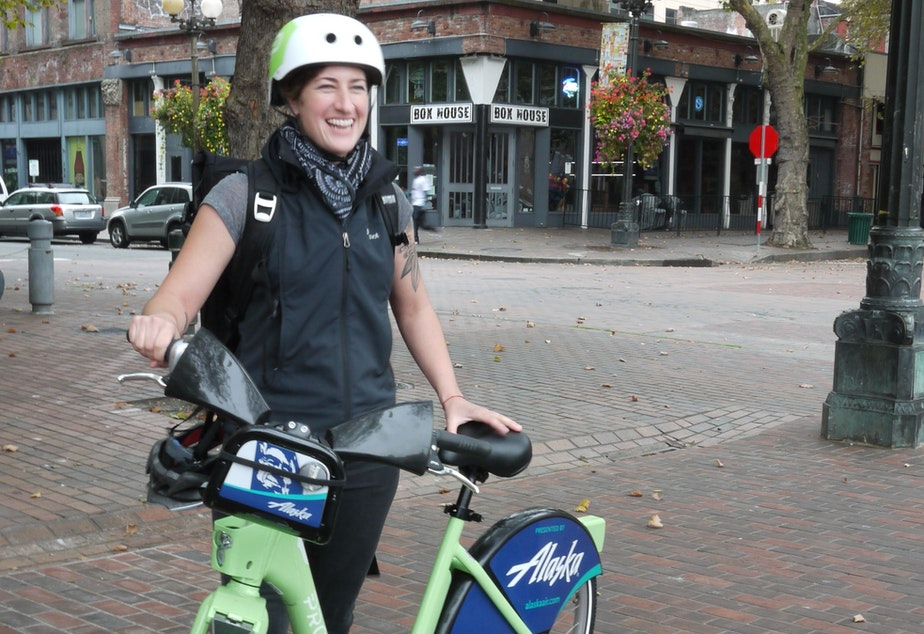 Holly Houser, Pronto's Executive Director, demonstrates Seattle's new bicycle share program.
