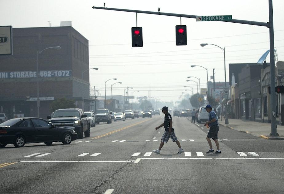 caption: Pedestrians cross a smoky North Wenatchee Avenue on Aug. 15, 2018, in Wenatchee.