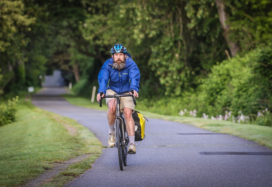 caption: A biker on the Burke-Gilman Trail.