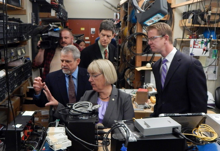 U.S. Sen. Patty Murray, center, and U.S. Rep. Derek Kilmer, right, get a tour of the Pacific Northwest Seismic Network from Paul Bodin, left, and John Vidale, rear.