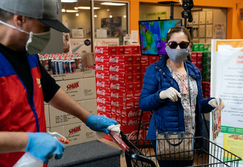 caption: Even without symptoms, you might have the virus and be able to spread it when out in public, say researchers who now are reconsidering the use of surgical masks.