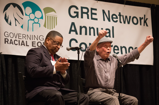 "Bob Santos (right) and Larry Gossett at a 2015 racial equity conference. Both men were part of the so-called ""Gang Of Four"" group of civil rights activists."
