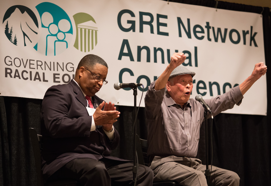 """Bob Santos (right) and Larry Gossett at a 2015 racial equity conference. Both men were part of the so-called """"Gang Of Four"""" group of civil rights activists."""