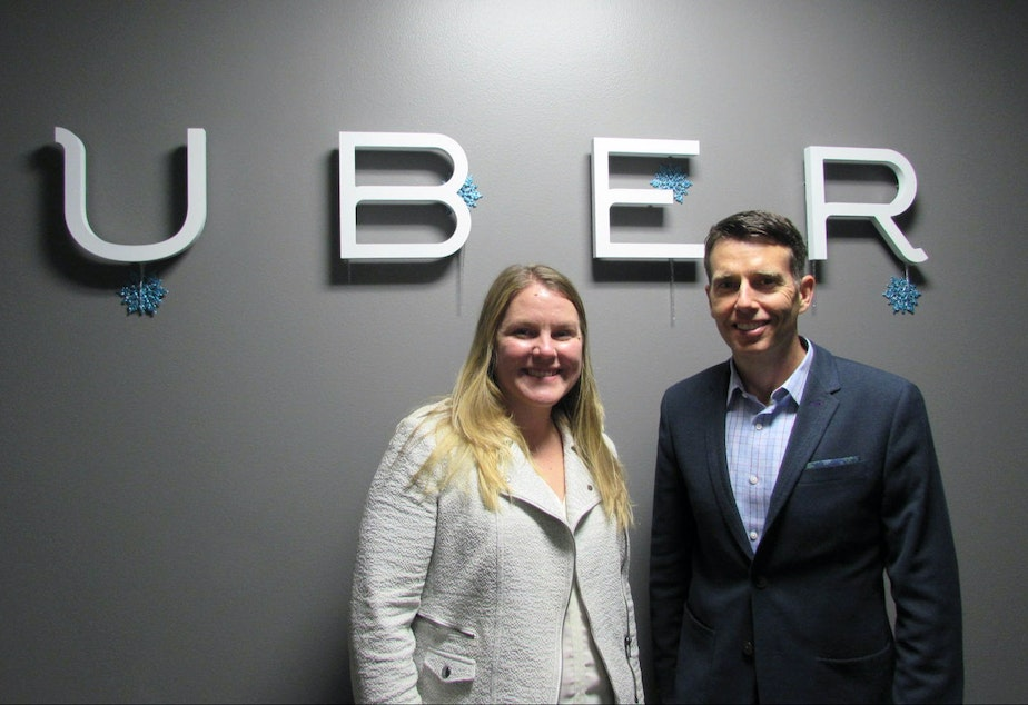 caption: Uber General Manager Brooke Steger and chief adviser David Plouffe at the company's Seattle offices.