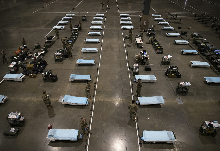 caption: U.S. Army soldiers from the 627th Army Hospital from Fort Carson, Colorado, as well as from Joint Base Lewis-McChord set up a military field hospital on Tuesday, March 31, 2020, at the CenturyLink Field Event Center in Seattle. The 250-bed hospital will be for non COVID-19 patients.