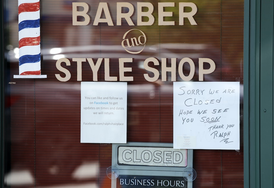 caption: A Seattle barbershop is closed (May 19, 2020) because of the coronavirus outbreak in the state.