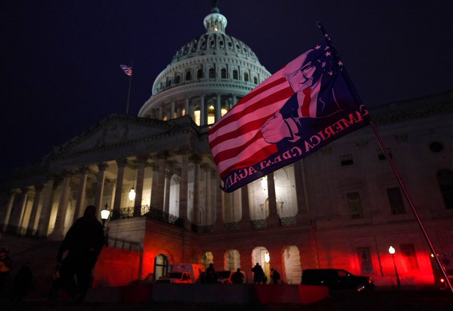 caption: Authorities stand guard outside the U.S. Capitol after supporters of President Donald Trump gathered Wednesday, Jan. 6, 2021, in Washington.