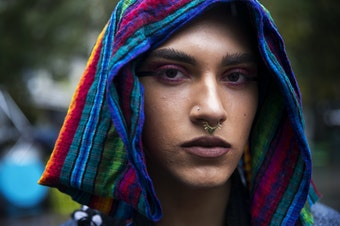 Kenta Puv, 19, poses for a portrait during the Indigenous People's Day march and celebration on Monday, October 8, 2018, at Westlake Park in Seattle.