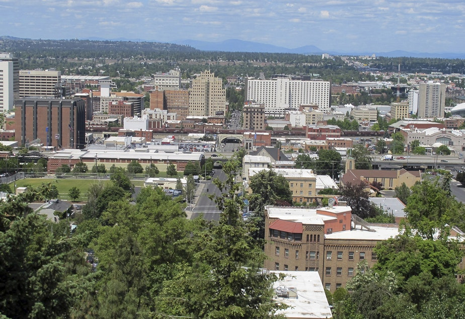 caption: In this photo taken June 4, 2018, the downtown skyline is shown from the South Hill in Spokane, Wash. The state's second-largest city is booming these days thanks to a good economy and influx of new residents.