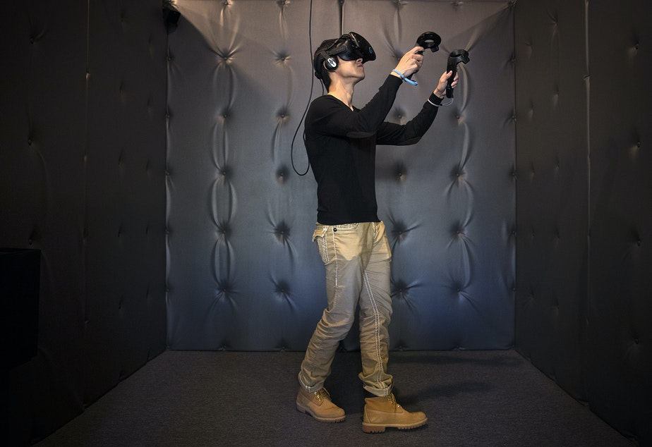 Kai Kao plays a virtual reality game on Friday, November 17, 2017, at Portal Virtual Reality Arcade and Lounge in Seattle. Tap or click on the first image to see more.