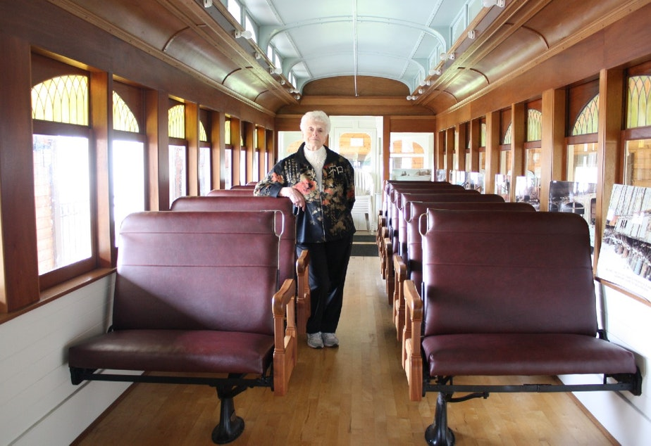"caption: Betty Lou Gaeng aboard a restored trolley that once ran the ""Interurban"" route linking Seattle to suburban communities like Alderwood Manor (now Lynnwood)"