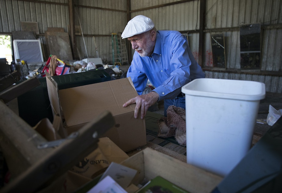 caption: David Williams, a 20-year full-time resident of Orcas Island, sorts through garbage and recycling in the back of his truck on Sunday, July 30, 2017, on the tipping floor of the Orcas Island Transfer Station on Orcas Island.