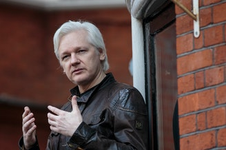 Julian Assange speaks to the media from the balcony of the Ecuadorian Embassy in London last year.