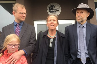 Defendant Emily Johnston (center) speaks outside Clearwater County courthouse, with co-defendant Ben Joldersma, left, and his daughter, and former NASA scientist James Hansen after she was acquitted along with two other defendants. Dan Kraker | MPR News