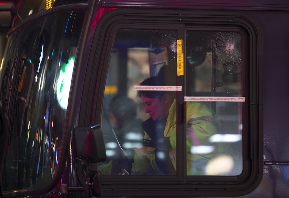 caption: Bullet holes are visible in a window of a metro bus following a shooting that left multiple victims injured and one dead on Wednesday, January 22, 2020, at the intersection of Third Avenue and Pike Street in Seattle.