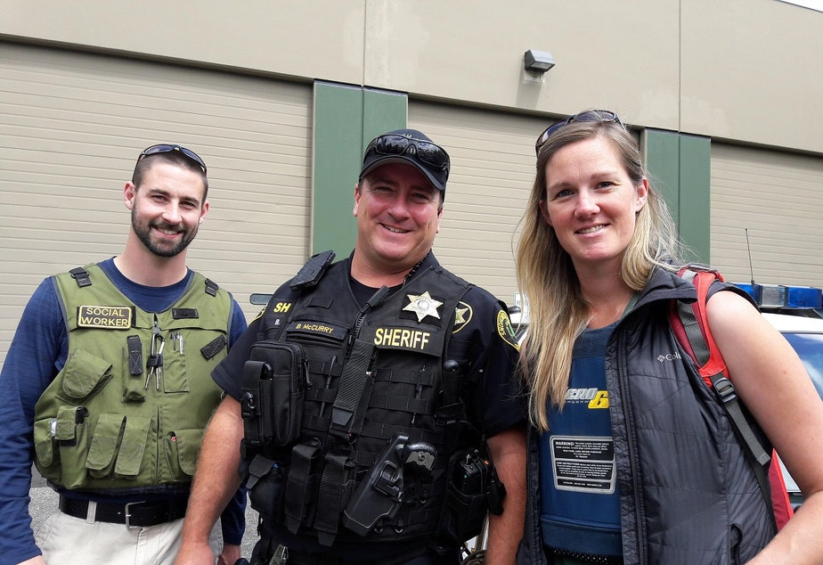 caption: Jesse Calliham, left, Deputy Bud McCurry, center, and Lauren Rainbow are part of Snohomish County's Office of Neighborhoods. The unit's sole focus is working with homeless people who use heroin. Click on this image for more photos.