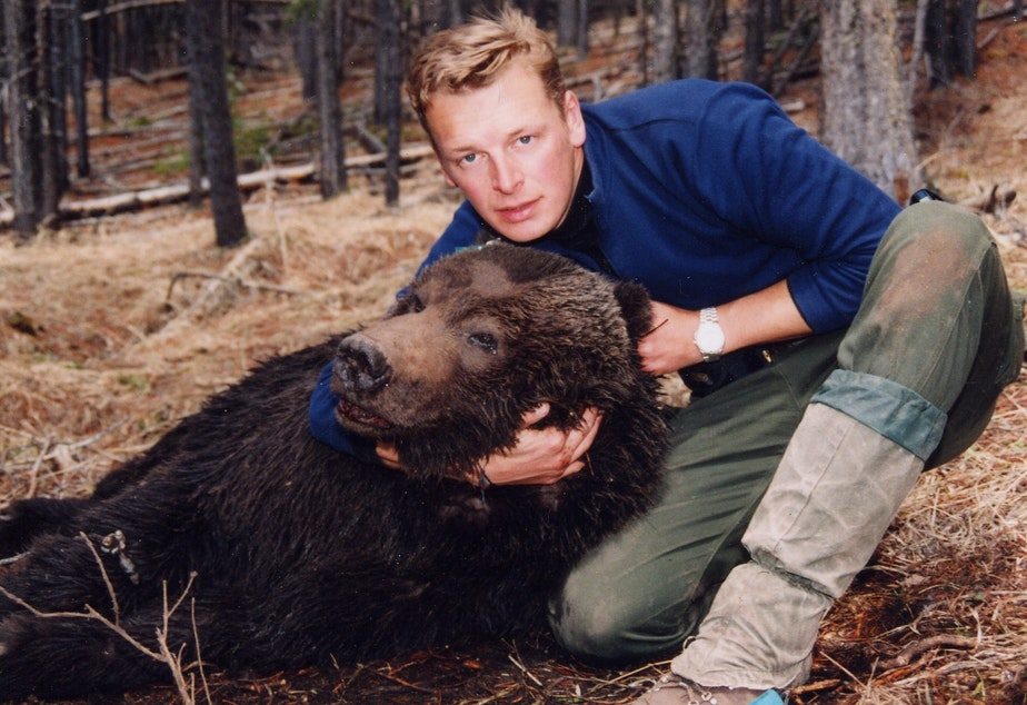 caption: Chris Morgan as a nervous 24-year-old with the first grizzly bear he ever captured while working on a research study in Canadian Rockies in 1994. Morgan named the bear Dawson.
