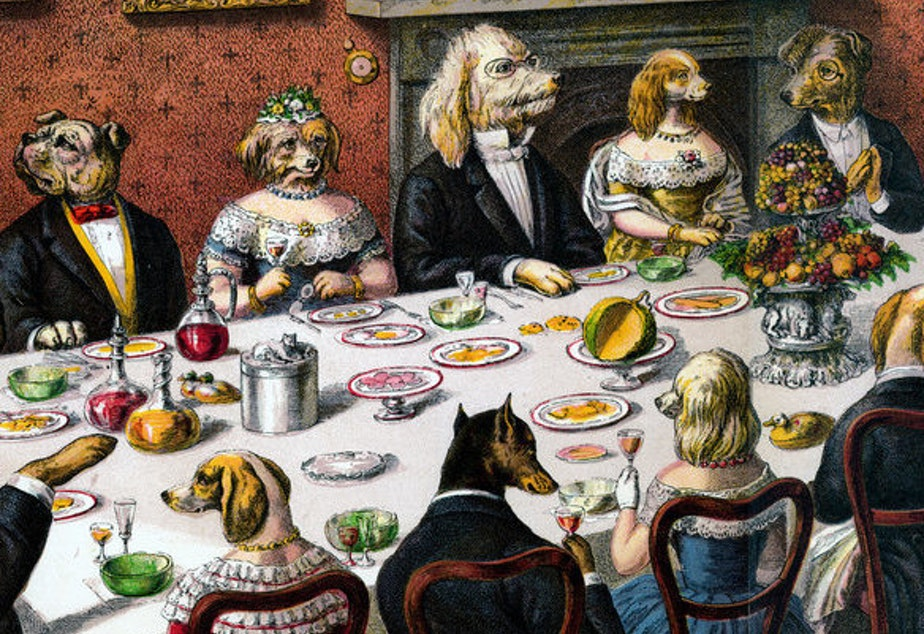 A group of well-dressed dogs take part in a banquet.